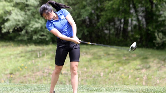 Carmel's Caitlin Tully competes during the first round