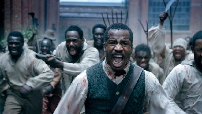 """Nate Parker plays Nat Turner in a scene from """"The Birth of a Naiton."""""""