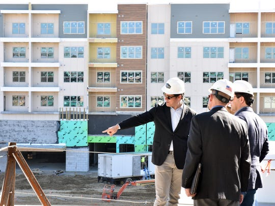 Ted Duckworth, left, principal over The District at Eastover, identifies several buildings that make up the northeast Jackson development during its construction phase. Duckworth planned to renovate the Carnegie Library in Jackson into 16 loft-style apartments and office space but ran into delays over preservation of the building's historic character.The project never materialized.