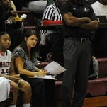 North Caddo co-head coaches Rickey Evans, standing, and Angela Channell, seated, have their Lady Rebels back in the LHSAA Class 2A semifinals for a second consecutive season.