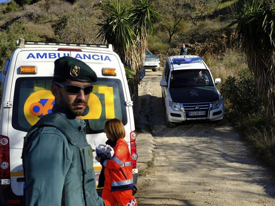 Emergency services look for a 2-year-old boy who fell into a well, in a mountainous area near the town of Totalan in Malaga, Spain, Jan. 14, 2019. More than 100 firefighters and emergency workers in southern Spain are searching for a 2-year-old toddler who fell into a narrow and deep well on Sunday.