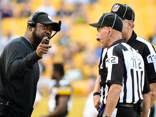 Pittsburgh Steelers coach Mike Tomlin talks with officials during the first against the Philadelphia Eagles in an NFL preseason football game in Pittsburgh on Thursday, Aug. 18, 2016. (AP Photo/Fred Vuich)