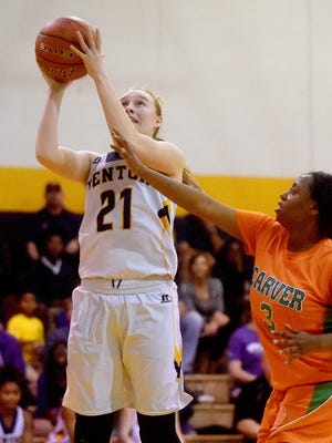 Benton's Emily Ward goes up for two of her 17 points against Carver Thursday night in Benton. Carver's Sabrina Boykins defends.