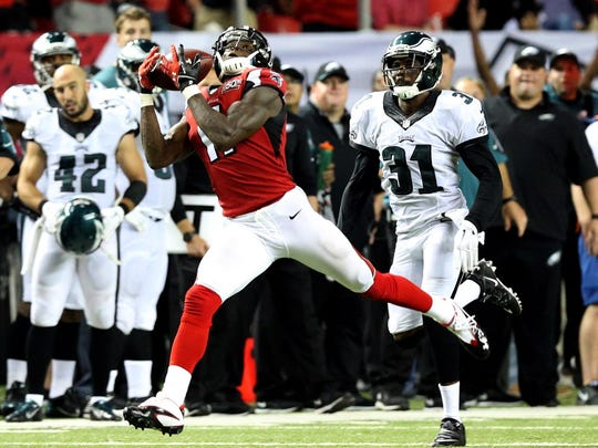 Falcons wide receiver Julio Jones (left) catches a pass in front of Eagles defensive back Byron Maxwell in the fourth quarter on Sept. 14, 2015. The play went for 46 yards.