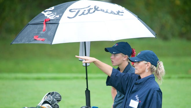 Sacred Heart's Erin Rowland gets some advice from her head coach, Leslie Bender on the 6th hole in the Region 5 golf championship at Weissinger Hills Country Club in Shelbville, Ky.29 Sept 2015