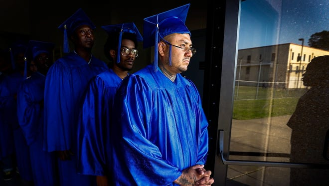 Shelby County Correctional Center inmate Francisco Alvarado (front) waits to take part in HopeWorks graduation Thursday evening. Prisoners received a certificate of completion for Personal and Career Development that will help them overcome their difficult struggles and offer them hope for the future.