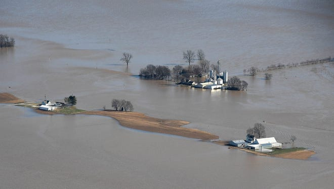 Flood surrounded farm houses in Vanderburgh County as the flooding Ohio River nears historic levels in the Tri-State Tuesday, February 27, 2018.
