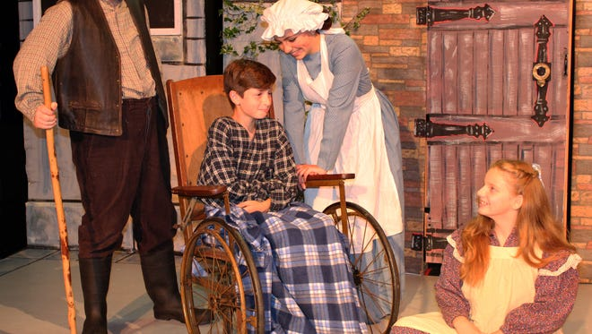 "Mary Lennox (played by Abbie Simon, right) finds unexpected friendships with Dickon (Chris Simon, left), Colin (Steven George, in wheelchair), and Martha (Alexa Scano) in ""The Secret Garden.""  The award-winning musical will be staged at Brundage Park Playhouse from October 6 through 22."