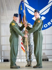 Lt. Col. Mark Sletten, 8th Fighter Squadron commander, is presented command of the 8th FS by Col. James Keen, 54th Fighter Group commander, during an activation ceremony at Holloman Air Force Base, N.M. Aug. 4, 2017.