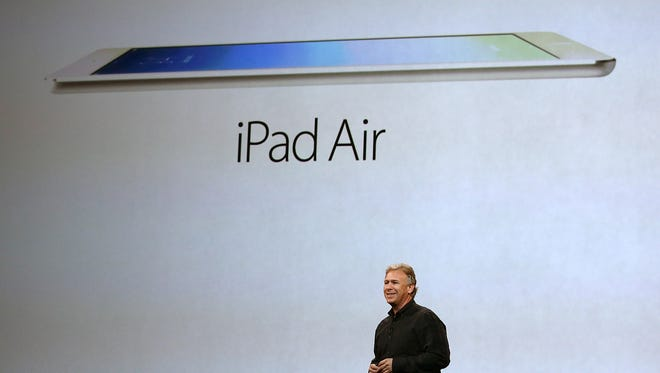 Apple's Phil Schiller announces the new iPad Air during an event in San Francisco.