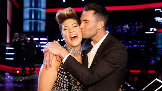 Maroon 5 frontman and NBC's 'The Voice' coach Adam Levine kisses Tessanne Chin on the cheek after Chin was announced the Season 5 winner of the talent contest.