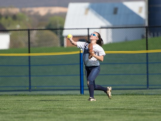 Chambersburg centerfielder Taylor Myers throws the