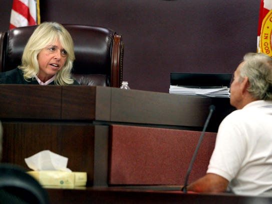 Judge Jackie Fulford, left, asks fisherman Jonas Porter