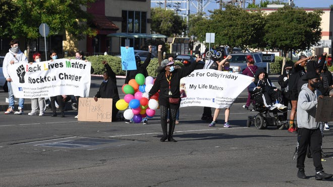Protesters block traffic on Hammer Lane and Lower Sacramento Road on Friday evening during a protest in Stockton. Protesters slowed and stopped westbound traffic on Hammer Lane for more than an hour before police moved the group off the street.