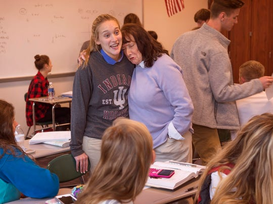 North High School teacher Jane Bernhardt gives student Katie Rieswick a pitying hug knowing how hard it is being a high school student in her pre-calculus class earlier this year.