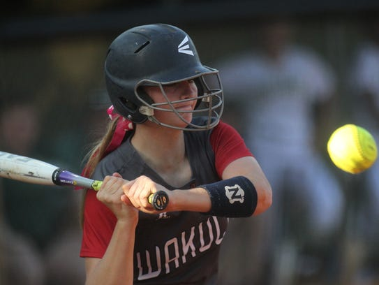 Wakulla's Kat McGlamry watches a pitch sail in high.