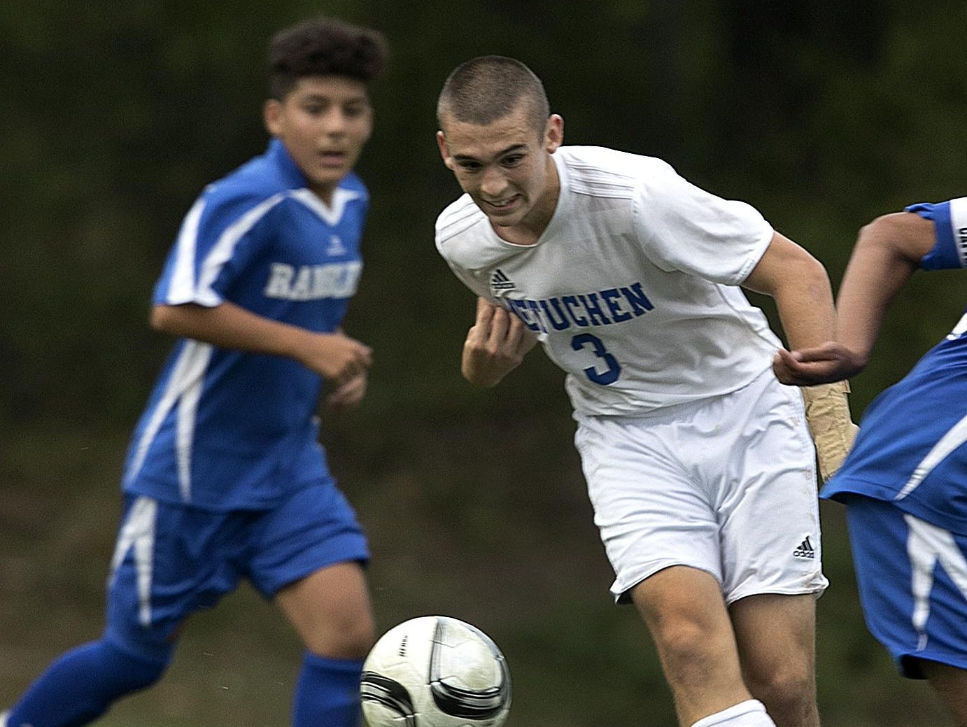 Metuchen's Cameron O'Connell goes after the ball against Carteret on Monday.