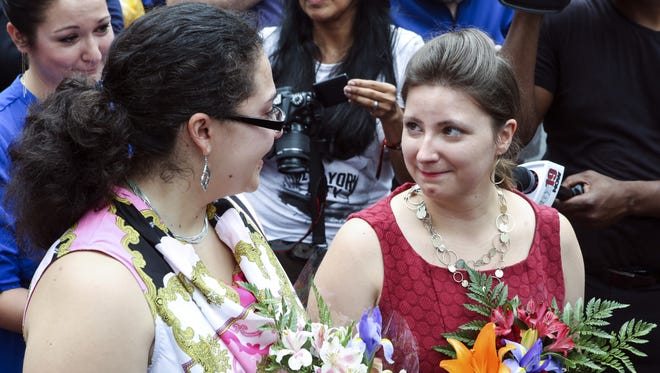 Nevi Kotzeva (left) and Maggie Best-Miller stand in a crowd waiting to get married on Fountain Square. Five same-sex couples were married Friday ruling following the landmark Supreme Court ruling legalizing same-sex marriage in all states.