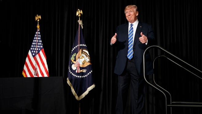 President Donald Trump gives a thumbs up as he arrives to speak to the Major County Sheriffs' Association and Major Cities Chiefs Association on Wednesday, Feb. 8, 2017, in Washington.