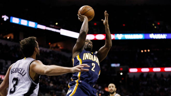 Indiana Pacers point guard Rodney Stuckey (2) shoots the ball against the San Antonio Spurs during the first half at AT&T Center on Nov. 26, 2014.