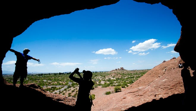 Matt Mrachek and Maria Vu take photos at the iconic Hole-in-the-Rock spot in Papago Park in 2015.