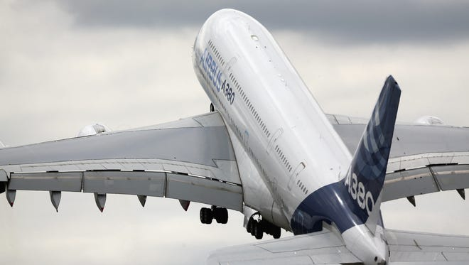 An Airbus A380 performs an aerial flying display on day four of the Farnborough Airshow on July 16, 2014.