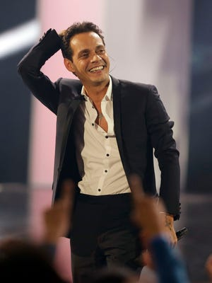 Singer Marc Anthony smiles after performing during the Latin Billboard Awards, Thursday, April 24, 2014, in Coral Gables, Fla. Anthony won 10 awards. (AP Photo/Lynne Sladky) ORG XMIT: XMH161