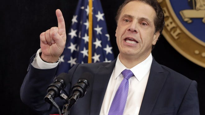 """New York Gov. Andrew Cuomo announced Tuesday that his state now """"highly discourages"""" any non-essential travel to and from Massachusetts."""