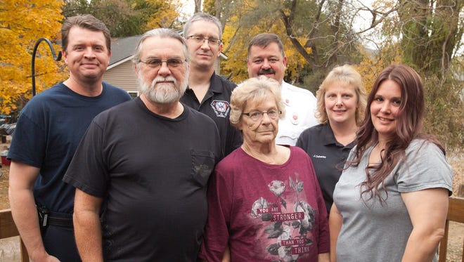 Jane Kitchenmaster, center, flanked by her husband Fred and daughter Kristine Spisz, had an opportunity to thank members of the Hartland Area Fire Department for bringing her back to life. Those firefighters pictured are, from left, firefighter Aaron Waldron, Sgt. Ron Duncan, Capt. Jon Dehanke and his wife Engineer Jennifer Dehanke.
