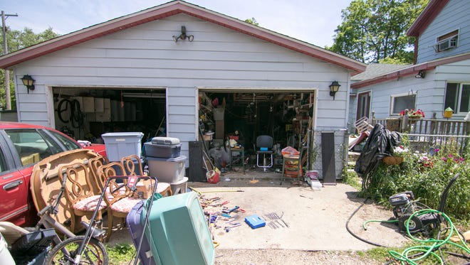 This home at 522 W. Washington St. in Howell, shown Tuesday, June 26, 2018, has prompted neighbors to ask the Howell City Council to tighten rules for what is allowed in local yards.