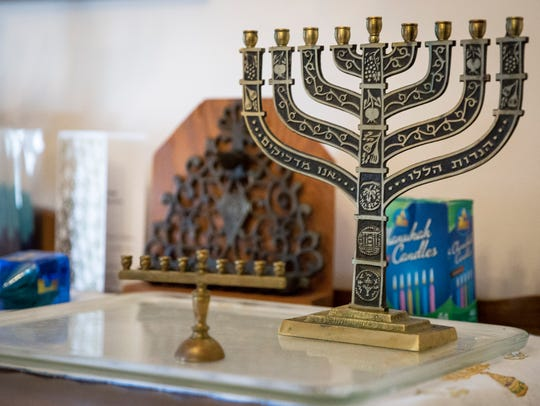 Traditional Jewish symbols adorn a table in the Spodek's