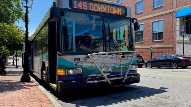 A COAST bus makes a stop in downtown Portsmouth.