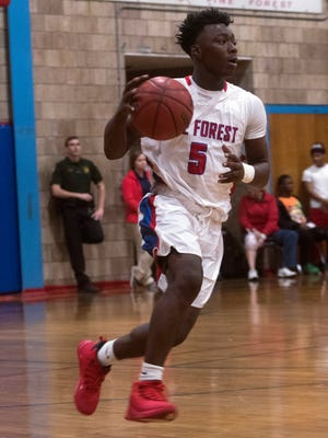 Pine Forest guard, Zo Turner, move the ball up court during Friday night's district game against Washington.