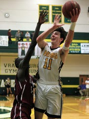 Hendersonville's Cooper Smith shoots over Gallatin's