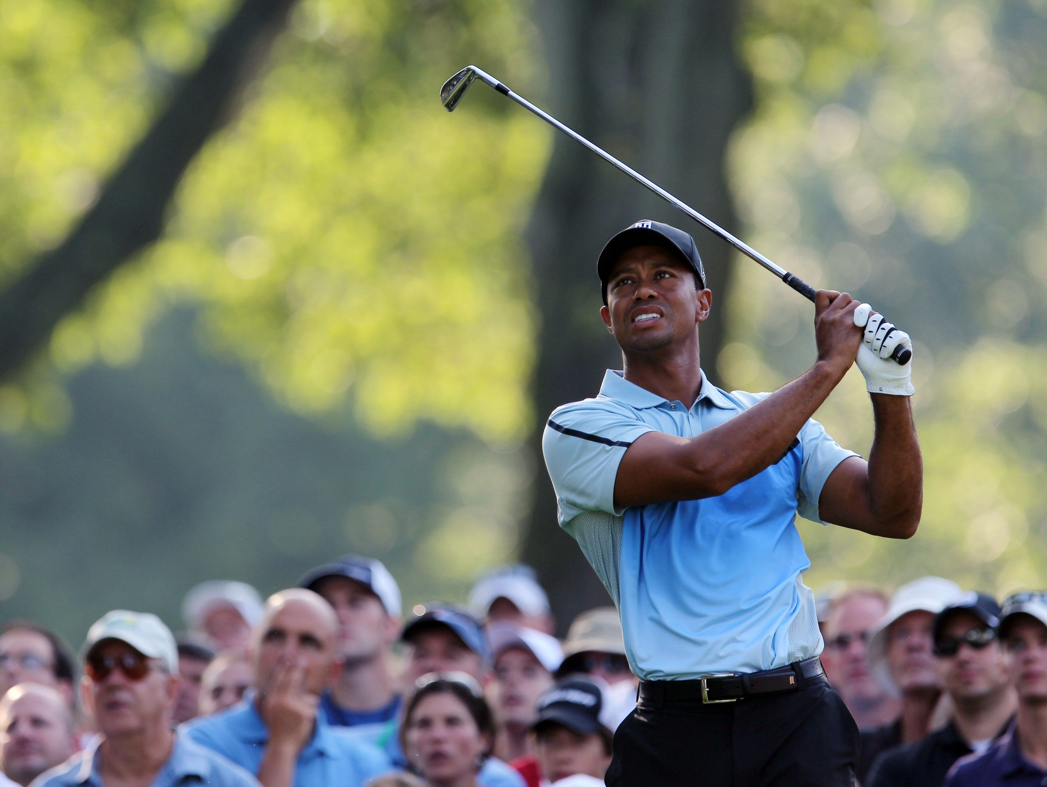 Tiger Woods tees off on the 11th hole during the first round of the 95th PGA Championship at Oak Hill Country Club.
