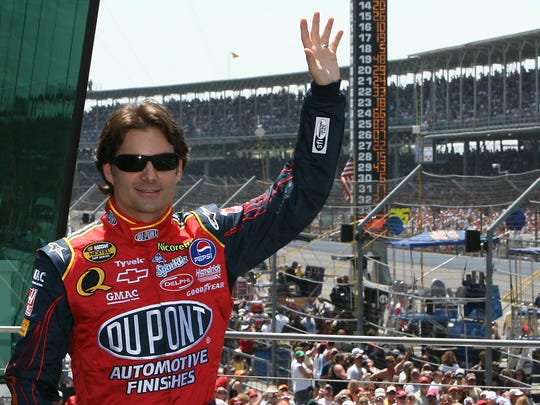 FILE - Jeff Gordon waves to the fans as he is introduced at the 2007 Allstate 400 at the Brickyard.