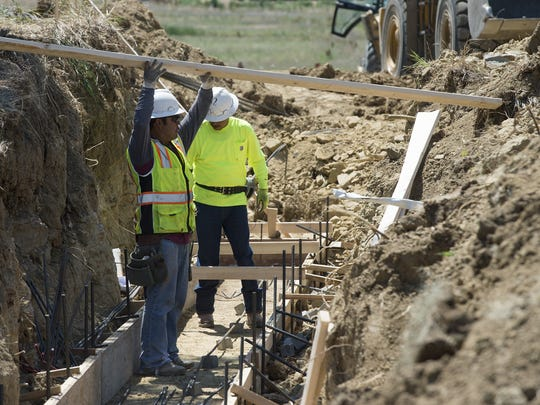 Work continues on the Front Range Trail near Colorado Highway 392, east of Lemay Avenue in south Fort Collins on Friday, June 30, 2017. Additions to the trail will connect a path between Loveland and Fort Collins.