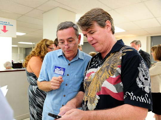State Rep. Glen Casada, left, looks at early voting returns with Williamson County commissioner Jeff Ford.