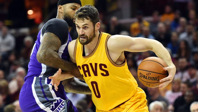 Cleveland Cavaliers forward Kevin Love (0) drives to the basket against Sacramento Kings forward DeMarcus Cousins (15) during the first quarter at Quicken Loans Arena.