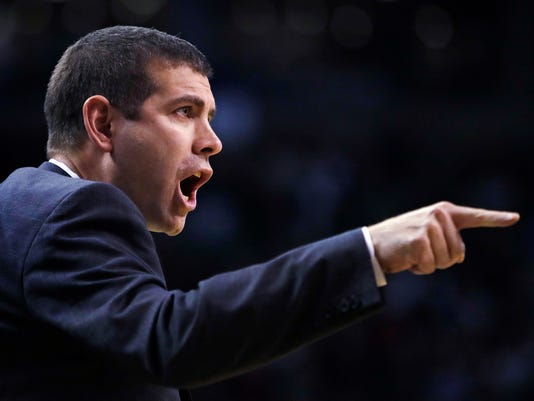 Boston Celtics head coach Brad Stevens argues with an official during the second half of an NBA basketball game against the Dallas Mavericks in Boston, Wednesday, Dec. 6, 2017. The Celtics defeated the Mavericks 97-90. (AP Photo/Charles Krupa)