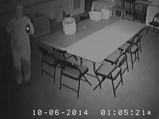 Surveillance video from St. Maximillian Kolbe Parish Center shows someone dressed in light colored clothing, a ball cap and wearing gloves.