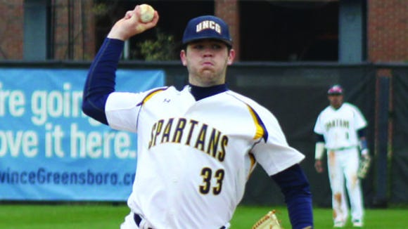 Enka alum Matt Frisbee is a freshman pitcher at UNC Greensboro.