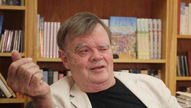 """In this July 26 photo, Garrison Keillor, creator and former host of, """"A Prairie Home Companion,"""" talks at his St. Paul office. Keillor said today that he's been fired by Minnesota Public Radio over allegations of improper behavior. (AP Photo/Jeff Baenen, File)"""