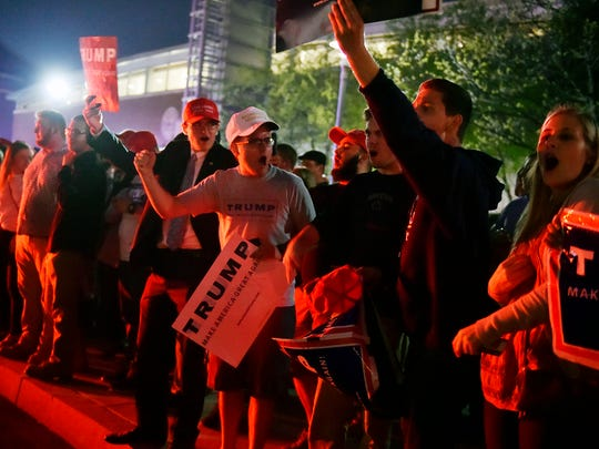 Donald Trump supporters yell at protesters across a driveway after a rally for the Republican presidential candidate Thursday, April 21, 2016, outside the Pennsylvania Farm Show Complex in Harrisburg. The Pennsylvania presidential primary is April 26.