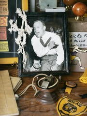 Memorabilia from the 1954 state champion Milan glory days fills the Milan '54 Museum in Milan, Ind., such as this whistle, framed photo of coach Marvin Wood, and a piece of net.