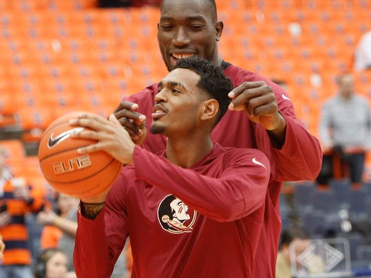 Florida State's Michael Ojo, right, distracts teammate Xavier Rathan-Mayes, left, while shooting foul shots before an NCAA college basketball game in Syracuse, N.Y., Saturday, Jan. 28, 2017. (AP Photo/Nick Lisi)