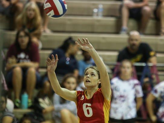 Palm Desert's Danielle Boss sets the ball against La