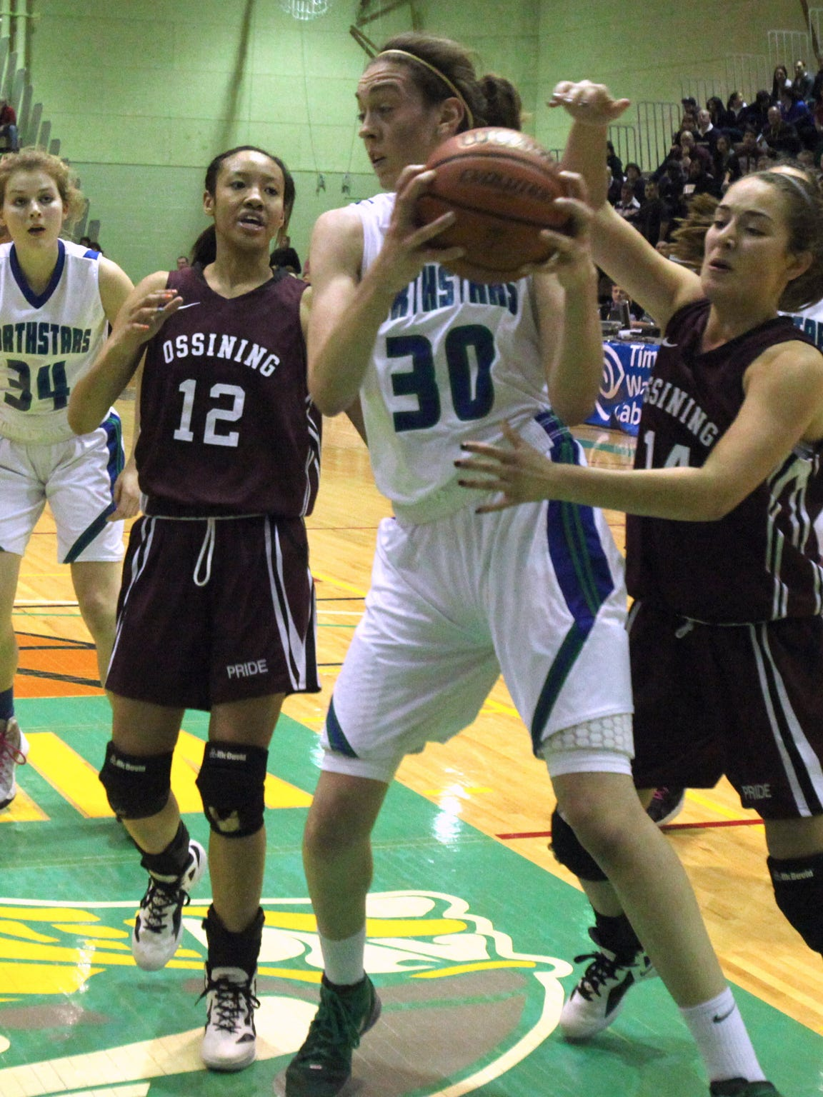 Ossining's Daniella Ferrao, right, pressures Cicero North's Breanna Stewart during their NYSPHSAA Class AA state championship semifinal at Hudson Valley Community College in Troy March 16, 2012. Ossining lost 79-51.