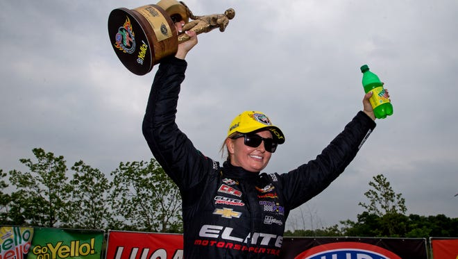 NHRA pro stock driver Erica Enders-Stevens celebrates after winning the Spring Nationals at Royal Purple Raceway.