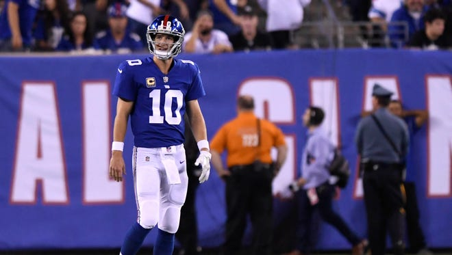 New York Giants quarterback Eli Manning (10) reacts after throwing an interception in the first half against the Detroit Lions during a NFL football game at MetLife Stadium.